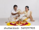 couple celebrating onam | Shutterstock . vector #569297905