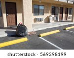 garbage bag infront of motel... | Shutterstock . vector #569298199