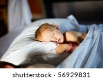Adorable toddler girl in bedroom at the morning - stock photo