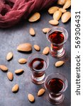 Small photo of Almond liquor amaretto on a grunge black table