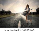 woman holding a guitar standing ...   Shutterstock . vector #56931766
