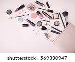 a pink make up bag with... | Shutterstock . vector #569330947