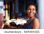 side portrait of smiling young... | Shutterstock . vector #569345101