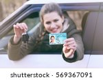 woman with driving license and... | Shutterstock . vector #569367091