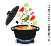 cooking concept. on the stove ... | Shutterstock .eps vector #569373619