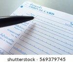 pen over blank of arrival card...   Shutterstock . vector #569379745