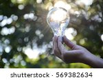hand of person holding light... | Shutterstock . vector #569382634