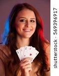 beautiful brunette holding four ... | Shutterstock . vector #569396917