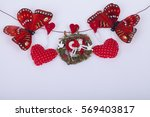 red ribbon with hearts  on a...   Shutterstock . vector #569403817