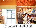 man shopping in supermarket... | Shutterstock . vector #569412181