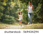 mother and daughter playing and ... | Shutterstock . vector #569434294