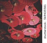 more red umbrella in chiang mai ... | Shutterstock . vector #569435581