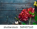 italian ham  prosciutto and... | Shutterstock . vector #569437165
