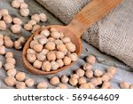 chickpeas in a wooden spoon and ... | Shutterstock . vector #569464609