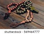 wooden religious rosary   Shutterstock . vector #569464777