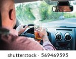 in the picture a man drinking... | Shutterstock . vector #569469595