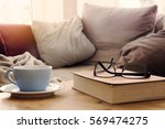 closeup of cup and book with... | Shutterstock . vector #569474275