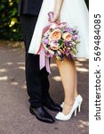 bride and groom in the park ... | Shutterstock . vector #569484085