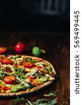 delicious fresh pizza served on ...   Shutterstock . vector #569499445