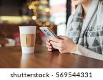 woman typing text message on... | Shutterstock . vector #569544331