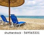 reeds umbrella and empty deck... | Shutterstock . vector #569565331