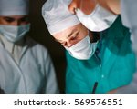 the surgeon makes an operation. | Shutterstock . vector #569576551