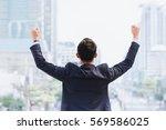 celebrating success. back view... | Shutterstock . vector #569586025