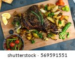 roast shoulder of lamb on baked ... | Shutterstock . vector #569591551