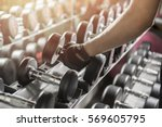 close up of man holding weight... | Shutterstock . vector #569605795