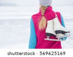 woman looking at lake ice with... | Shutterstock . vector #569625169