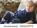 toddler boy in dirty shirt... | Shutterstock . vector #569625979