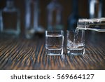 russian vodka pouring from the... | Shutterstock . vector #569664127