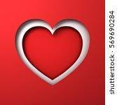 red paper cut heart hole...   Shutterstock . vector #569690284