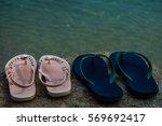 flip flops on a sandy ocean... | Shutterstock . vector #569692417