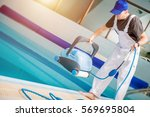 Swimming Pools Technician with Pool Cleaning Robot Preparing For Work. Caucasian Technician Cleaning Professional. - stock photo