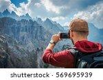 hiking tourist taking photos...   Shutterstock . vector #569695939