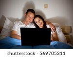 happy couple watching a video | Shutterstock . vector #569705311