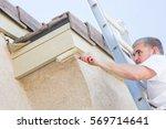 professional painter using a... | Shutterstock . vector #569714641