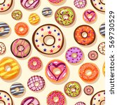colorful donuts with sprinkles... | Shutterstock .eps vector #569730529