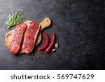 raw striploin steak with... | Shutterstock . vector #569747629