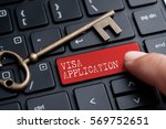 Small photo of Closed up finger on keyboard with word VISA APPLICATION
