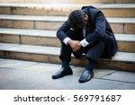 Stressed Businessman Sitting A...