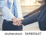 Small photo of Happy team worker has a business meeting in a modern city.Community Business team conference outside office. Volunteer Team collaborator worker discussing with hands together after complete deal .