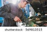mechanic in overalls checks...   Shutterstock . vector #569813515