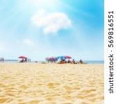 sand on the beach and sun in... | Shutterstock . vector #569816551