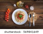 pasta on the wooden background | Shutterstock . vector #569841649