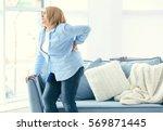 senior woman suffering from... | Shutterstock . vector #569871445