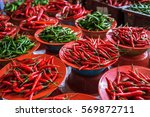 colorful chilli peppers stall ... | Shutterstock . vector #569872711