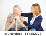 adult daughter assisting senior ...   Shutterstock . vector #569882329