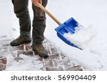 Man Removing Snow From The...